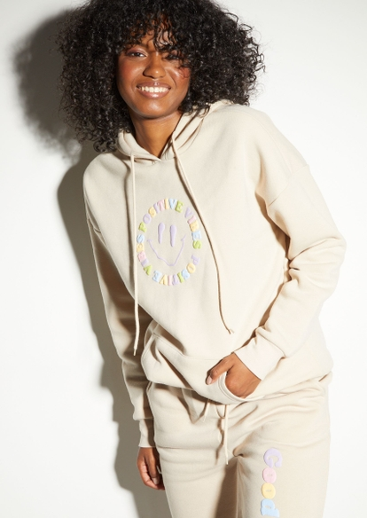taupe positive smiley face puff graphic hoodie - Main Image