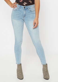 ultimate stretch light wash mid rise jeggings - Main Image
