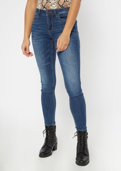 ultimate stretch dark wash mid rise jeggings - Main Image