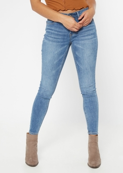 ultimate stretch medium wash mid rise jeggings in short - Main Image