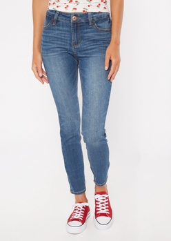 ultimate stretch dark wash mid rise jeggings in short - Main Image