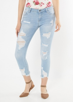 light wash ripped frayed hem jeggings - Main Image