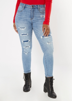 light wash distressed hem rip repair  jeans - Main Image