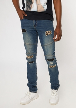 medium wash ripped repaired cheetah backed stacked skinny jeans - Main Image