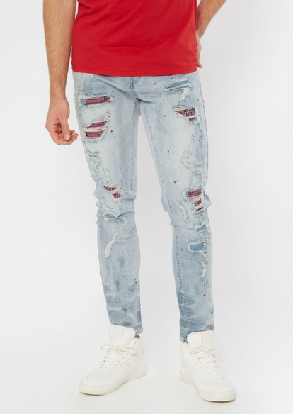 light wash ripped and studded repaired skinny jeans - Main Image