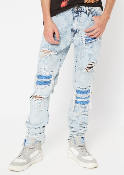 light wash repaired destruction stacked skinny jeans - Main Image