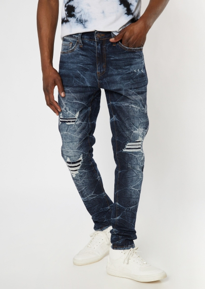 dark wash cracked ripped and repaired skinny jeans - Main Image