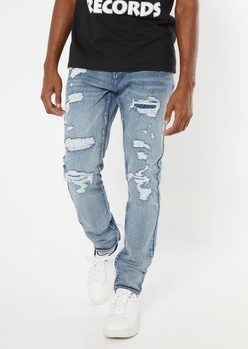 medium wash ripped and repaired skinny jeans - Main Image