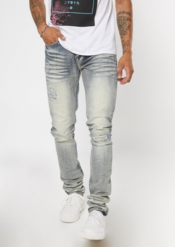 light tinted wash ripped and repaired stack skinny jeans - Main Image