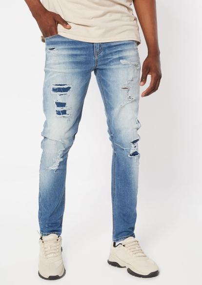 medium wash rip repair skinny jeans - Main Image