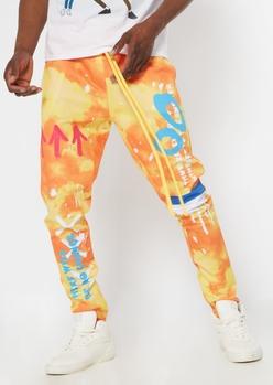 orange tie dye graffiti print track pants - Main Image