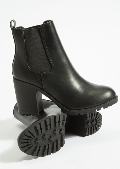 black faux leather lug sole booties - Main Image